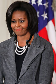 Michelle Obama's multi-strand pearl necklace was a lovely complement to her no-frills suit.