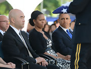 Michelle Obama kept her hairstyle sleek and subdued for a military funeral service in 2012.