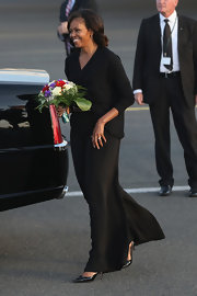 Michelle Obama wore a flowing black dress and cardigan for her visit to Berlin.