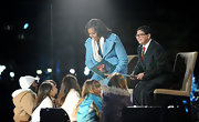 Michelle Obama chose a bright turquoise wool coat for the National Christmas Tree Lighting Ceremony.