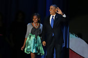 Sasha Obama celebrated her father's victory wearing a girly print skirt, cardigan, and bow-embellished blouse.