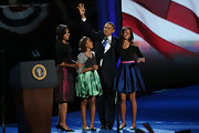 This gorgeous blue silk A-line skirt was feminine chic on Malia Obama.