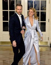 Blake Lively attended the State Dinner in honor of Prime Minister Trudeau wearing a bluish-silver satin wrap gown by Ralph & Russo.