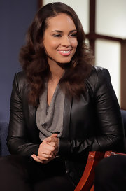 Alicia Keys looked pretty and polished with her shiny locks in soft waves during a round table discussion on World AIDS Day.