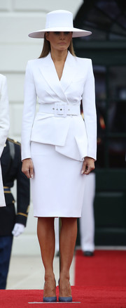 Melania Trump styled her white outfit with slate-blue pumps.
