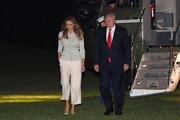 Melania Trump returned to the White House after her Saudi Arabia trip wearing white capris and a mint-green cardigan.