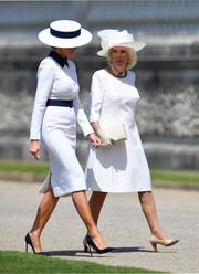 Melania Trump arrived at Buckingham Palace wearing a fitted white and blue shirtdress by Dolce & Gabbana.
