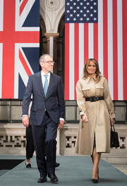 Melania Trump bundled up in a stylish beige trenchcoat by Celine for day two of the State Visit to England.