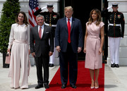Melania Trump looked effortlessly stylish in a pink leather wrap dress by Proenza Schouler at the welcome ceremony for King Abdullah and Queen Rania of Jordan.