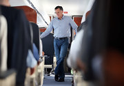 Mitt Romney paired a patterned blue button-down with jeans for a flight to Virginia.