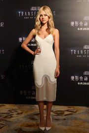 Nicola Peltz opted for simple white pumps to finish off her look.