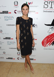 Kasia Smutniak attended the Cinema Italian Style press reception wearing a short-sleeve LBD subtly embellished with gold floral beading.