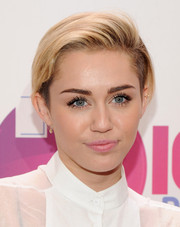 Miley Cyrus kept her beauty look soft and subtle with a swipe of pale pink lipstick during Z100's Jingle Ball.