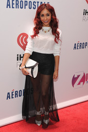 Nicole Polizzi layered a sheer black skirt over short shorts for a subtly sexy look during Jingle Ball.