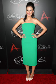 Torrey Devito showed off her svelte figure in a green Pas Pour Toi strapless dress during the 'Pretty Little Liars' 100th episode celebration.