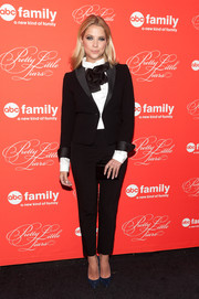 A black Saint Laurent tie added a feminine touch to Ashley Benson's suit.