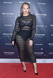 Iskra Lawrence's voluptuous figure was on full display in a sheer, body-con black dress at the PrettyLittleThing x Hailey Baldwin launch.