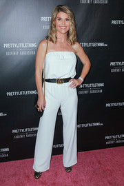 Lori Loughlin looked breezy in a strapless white jumpsuit at the PrettyLittleThing by Kourtney Kardashian launch.