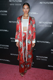 Shanina Shaik was boudoir-glam in a floral silk coat and matching pants at the PrettyLittleThing by Kourtney Kardashian launch.