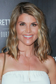 Lori Loughlin sported beach-chic waves at the PrettyLittleThing by Kourtney Kardashian launch.