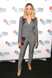 Joanne Froggatt completed her ensemble with basic nude pumps.