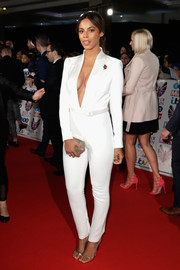 Rochelle Humes flashed some cleavage in a deep-V white jumpsuit by Barrus at the 2017 Pride of Britain Awards.
