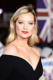 Laura Whitmore chose a classic red hue for her lips.
