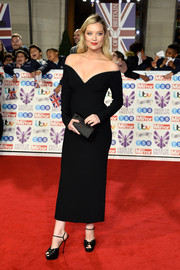 Laura Whitmore complemented her frock with towering black platforms.