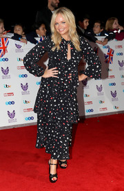 Emma Bunton paired her dress with black platform sandals.