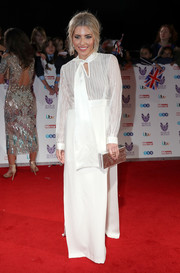 Mollie King opted for a white Jessica Choay combo dress, featuring a pussy bow and double side slits, when she attended the Pride of Britain Awards.