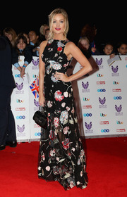 Laura Whitmore looked lovely at the Pride of Britain Awards in a Sandra Mansour gown rendered in an Oriental-inspired floral print.