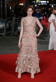 Ellie Bamber looked captivating in a petal-appiqued pink gown by Chanel at the European premiere of 'Pride and Prejudice and Zombies.'