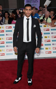 Black-and-white wingtip oxfords were an classy choice for Amir Khan at The Pride of Britain Awards in London.