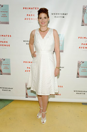 Debra Messing was summery in her sleeveless white cocktail dress during the 'Primates of Park Avenue' release event.