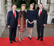 Charlene Wittstock wore a navy jersey dress with beaded neckline and three-quarter length sleeves at a reception in Dublin, Ireland.