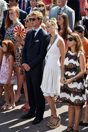Beatrice Borromeo teamed wedges with a sleeveless white dress for a summer-chic look during the Throne Celebrations.