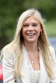 Chelsy Davy looked feminine in pale frosty pink lipstick.
