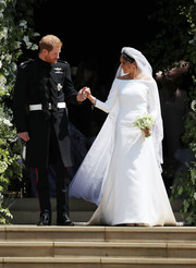 Meghan Markle opted for a simple yet oh-so-elegant Givenchy Couture off-the-shoulder gown, designed by Clare Waight Keller, for her wedding to Prince Harry.