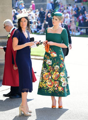 Lady Kitty Spencer's paired her dress with marigold velvet pumps and a matching clutch.