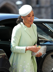Doria Ragland arrived for the wedding of Prince Harry and Meghan Markle carrying a monochrome box clutch by Oscar de la Renta.