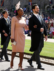 Serena Williams looked classy in a blush Atelier Versace dress with an asymmetrical neckline at the wedding of Prince Harry and Meghan Markle.