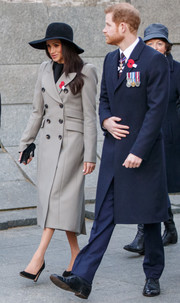 Meghan Markle headed to an Anzac Day dawn service wearing a double-breasted gray coat by Smythe.