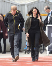 Meghan Markle went tough-chic in an army-green trenchcoat by Babaton while attending the UK team trials.