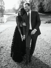 Meghan Markle chose an enchanting black Ralph & Russo Couture gown with a sheer, embellished bodice and a voluminous ruffle skirt for her official engagement photo shoot.