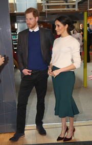 A green Greta Constantine pencil skirt with a mermaid hem completed Meghan Markle's outfit.