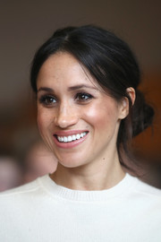Meghan Markle wore her hair in a casual-glam side chignon during her visit to Belfast.