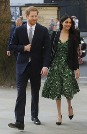 Meghan Markle finished off her dress with a tailored blazer by Alexander McQueen.