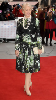 Helen Mirren chose a pleated floral frock for her feminine and fun look on the red carpet of the Prince's Trust and Success Awards.