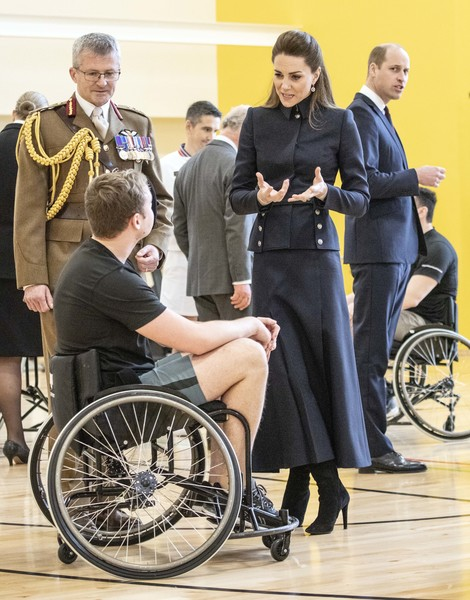 Kate Middleton was military-chic in a navy skirt suit by Alexander McQueen while visiting Leicestershire.