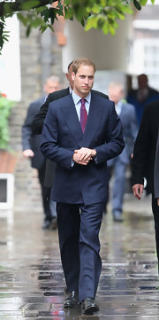 Prince William wore a double-breasted navy suit with an iridescent magenta tie to be a Royal Bencher at Middle Temple.